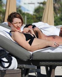 http://img255.imagevenue.com/loc363/th_312201136_Mischa_Barton_Bikini_Candids_on_the_Beach_in_Miami_December_27_2011_147_122_363lo.jpg